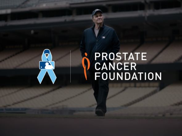 man in stadium with prostate cancer foundation logo in front