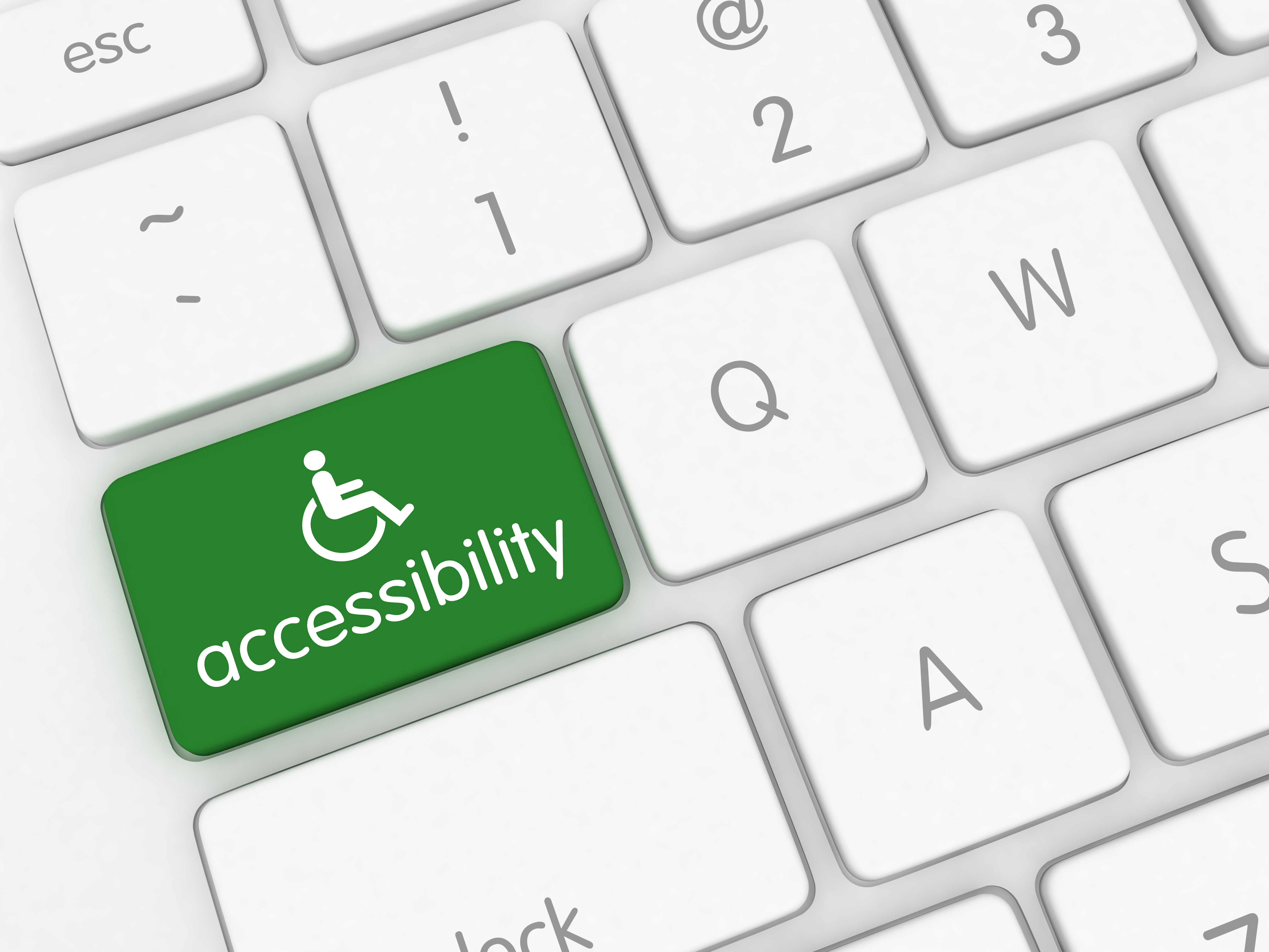 close up of keyboard keys and one key is labeled accessibility with the wheelchair symbol