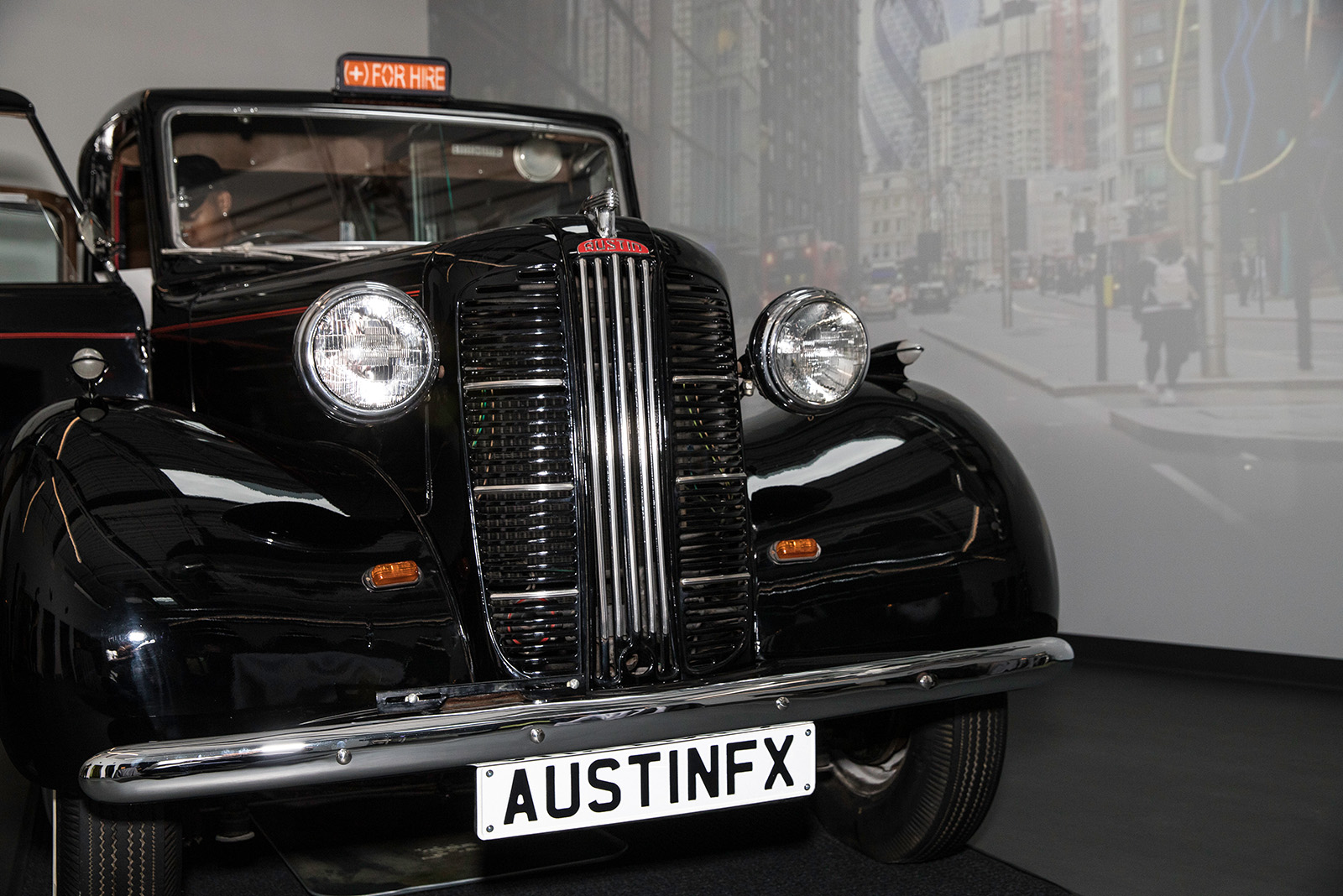 An antique London taxi cab inside the offices of (add)ventures.